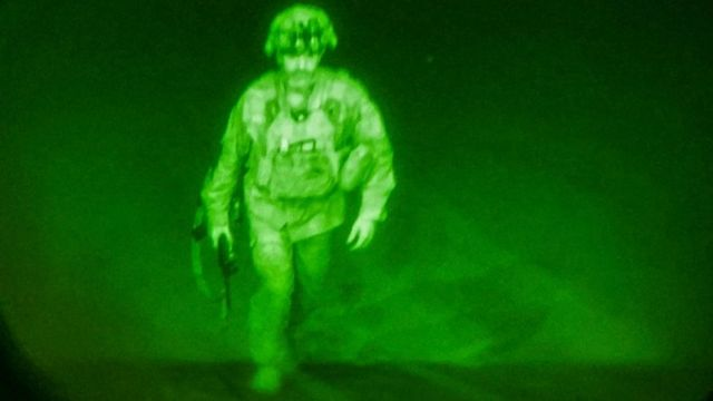 The indoor camera image shows walking in military uniform.