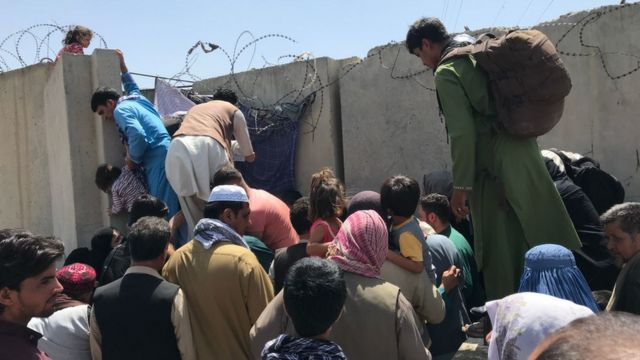 People are trying to break through the wall at Hamid Karzai International Airport