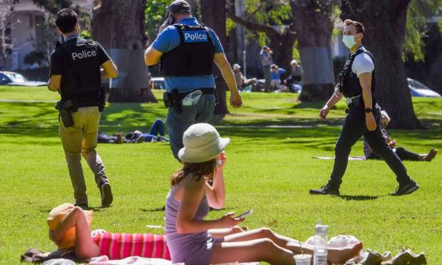 Police patrol the Carlton Gardens in Melbourne, Australia to prevent further demonstrations against Covid-19 rules Image: William West/AFP