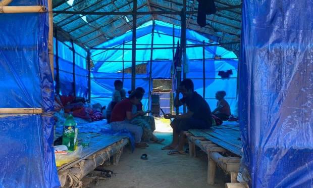 Myanmar refugees rest in a shelter at Farkaon quarantine camp in the eastern Indian state of Mizoram Photo: STR / AFP