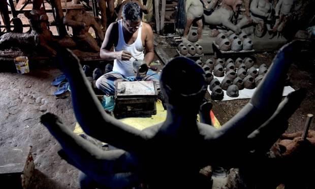 A craftsman attends a clay statue of Hindu goddess Durga before the Durga Puja festival in Vashi, Mumbai Image: INDRANIL MUKHERJEE / AFP