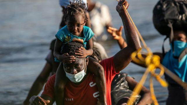Haitians cross the Rio Grande