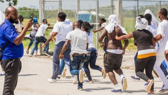 Haitians rush to Port-au-Prince airport after being deported