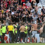 Fans of the Lens host invade the pitch at half-time to battle their visiting opponents Lille |  French football