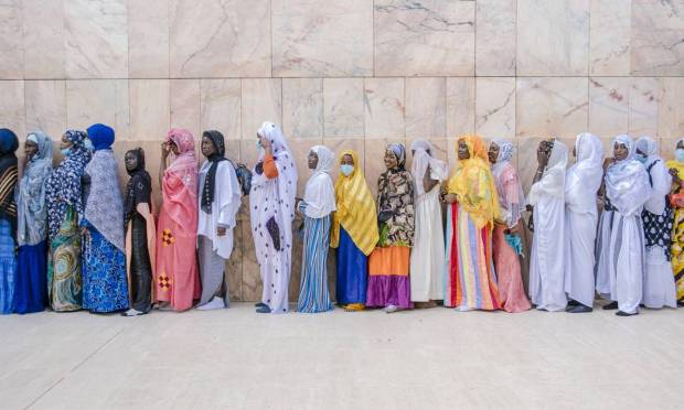 Pilgrims line up to enter the Duba Grand Mosque during Senegal's largest annual Muslim pilgrimage, the Grand Magal of Mauritius.  Photo: Carmen ABD Ali / AFP