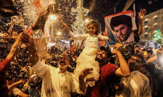Supporters of the Sadrist movement in Iraq cheer after the announcement of the preliminary results of the Iraqi parliamentary elections in Najaf, Iraq. Photo: Alaa Al-Marjani/Reuters